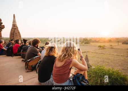 Tourists enjoying the sunset from Temple, Bagan (Pagan), Mandalay Region, Myanmar (Burma), Asia - Stock Photo