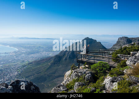 Family enjoying the view from Table Mountain over Cape Town, South Africa, Africa - Stock Photo
