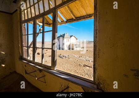 Window of an old colonial house, old diamond ghost town, Kolmanskop (Coleman's Hill), near Luderitz, Namibia, Africa - Stock Photo