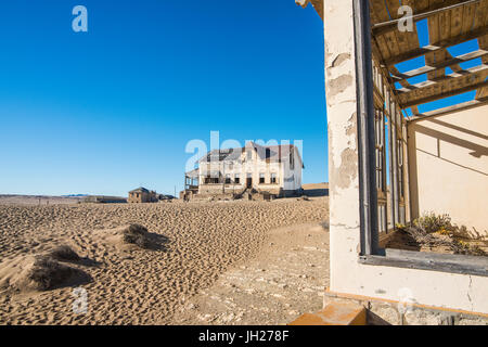 Colonial house, old diamond ghost town, Kolmanskop (Coleman's Hill), near Luderitz, Namibia, Africa - Stock Photo