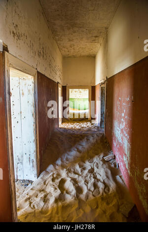 Sand in an old colonial house, old diamond ghost town, Kolmanskop (Coleman's Hill), near Luderitz, Namibia, Africa - Stock Photo