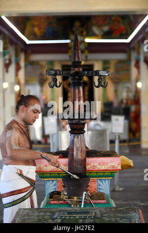 Hindu Brahmin priests.   Sri Mariamman Hindu temple.  Singapore. - Stock Photo