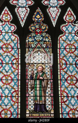 St Joseph's church.  Stained glass window. Saint Francis Xavier was Roman Catholic missionary.  Singapore. - Stock Photo