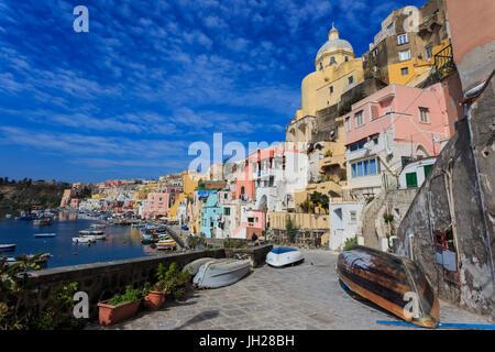 Marina Corricella, pretty fishing village, colourful fishermen's houses, boats and church, Procida Island, Bay of - Stock Photo
