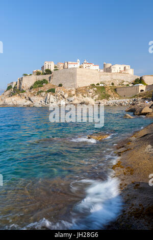 The old fortified citadel on the promontory surrounded by the clear sea, Calvi, Balagne Region, northwest Corsica, - Stock Photo