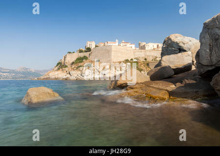 The old fortified citadel on the promontory surrounded by the clear sea, Calvi, Balagne Region, Corsica, France, - Stock Photo