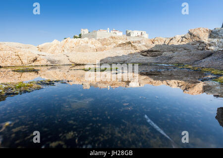 The ancient fortified citadel reflected in the blue sea, Calvi, Balagne Region, Corsica, France, Mediterranean, - Stock Photo