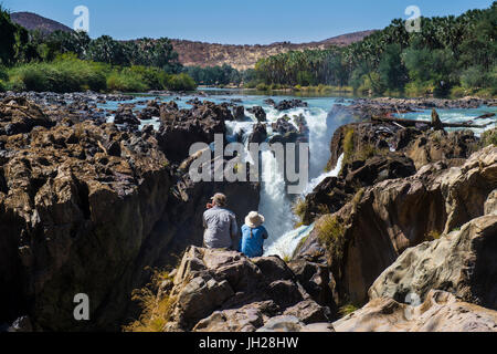 Epupa Falls on the Kunene River on the border between Angola and Namibia, Namibia, Africa - Stock Photo