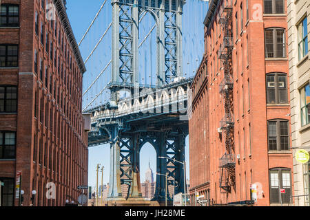 Manhattan Bridge and Empire State Building from Dumbo Historic District, Brooklyn, New York City, United States - Stock Photo