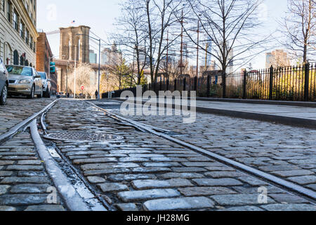Old rail tracks and cobbled street in Dumbo Historic District, Brooklyn, New York City, United States of America, - Stock Photo
