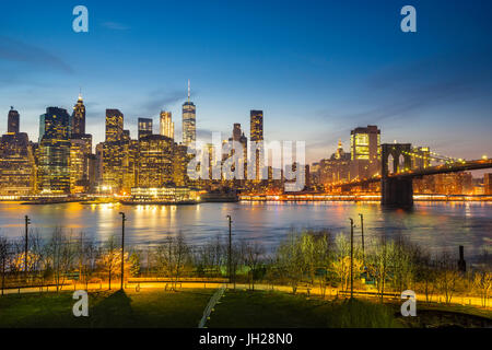 Manhattan skyline and Brooklyn Bridge at dusk, New York City, United States of America, North America - Stock Photo