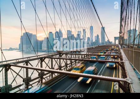 Rush hour traffic on Brooklyn Bridge and Manhattan skyline beyond, New York City, United States of America, North - Stock Photo