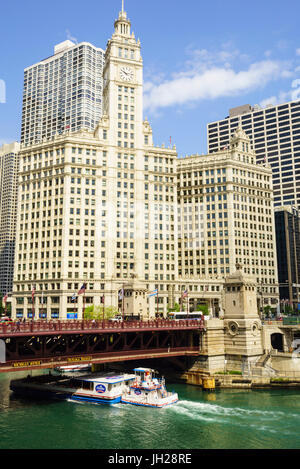 Sightseeing boat passing under DuSable Bridge on the Chicago River with Wrigley Building behind, Chicago, Illinois, - Stock Photo