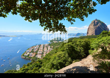 View from atop Morro da Urca with Sugarloaf mountain to the right, Rio de Janeiro, Brazil, South America - Stock Photo