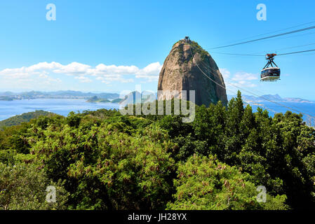 Cable car heading to Sugarloaf mountain seen from Morro da Urca, the first stop of the cable car, Rio de Janeiro, - Stock Photo