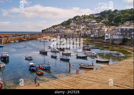 View of the harbour at mid-tide, Mousehole, Penwith, Cornwall, England, United Kingdom, Europe - Stock Photo