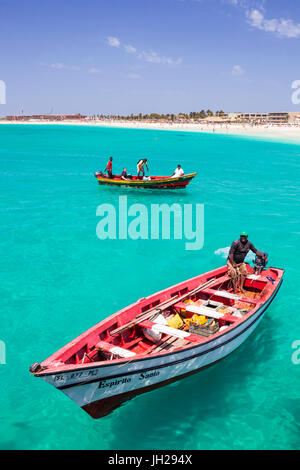 Fishermen bringing their catch of fish in fishing boats to Santa Maria, Sal Island, Cape Verde Islands, Atlantic, - Stock Photo