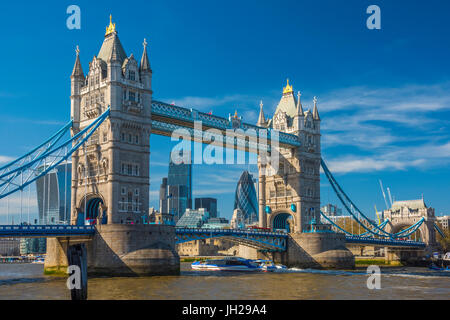 Tower Bridge over River Thames, City skyline including Cheesegrater and Gherkin skyscrapers beyond, London, England, UK Stock Photo