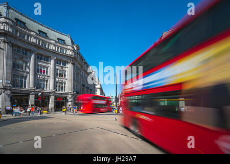 Double decker buses, Oxford Circus, West End, London, England, United Kingdom, Europe - Stock Photo