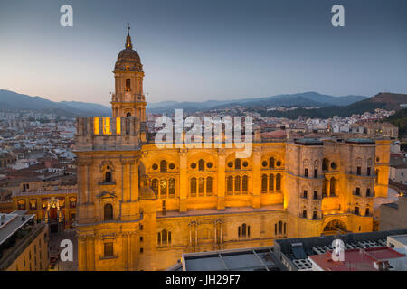 Elevated view of Malaga Cathedral at dusk, Malaga, Costa del Sol, Andalusia, Spain, Europe - Stock Photo