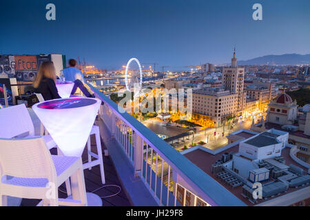 Elevated view of Malaga Marina and old town at dusk, Malaga, Costa del Sol, Andalusia, Spain, Europe - Stock Photo