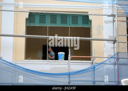 Builder renovating old french colonial house.  Vietnam. - Stock Photo