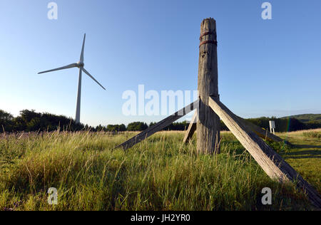 Remains of an old post windmill near a new wind turbine at Glyndebourne , East Sussex - Stock Photo