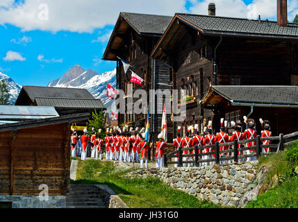 Grenadiers of Our Lord at the Corpus Christi procession, Blatten, Lötschental, Valais, Switzerland - Stock Photo