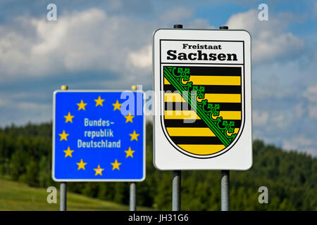 Sign with the coat of arms of the Freistaat Saxony and frontier sign of the Federal Republic of Germany,border crossing - Stock Photo