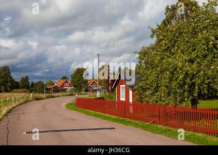 Typical scandinavian wooden houses in village. Dalarna county, Sweden. - Stock Photo