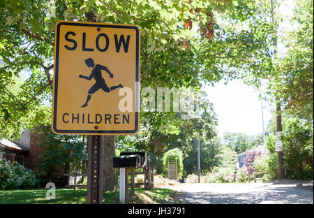 Slow Children warning sign urging motorists to slow down. - Stock Photo
