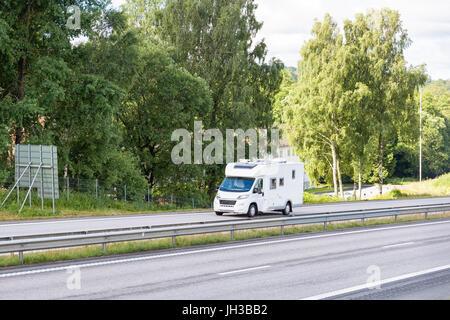 Motorhome campervan recreational vehicle RV travelling on motorway freeway highway  Model Release: No.  Property Release: No.