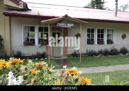 The 'Zippel-Haus' in Villa Baviera - formerly the meeting hall of the infamous Colonia Dignidad - now is a restaurant. - Stock Photo