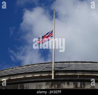 Flag at half mast - Stock Photo