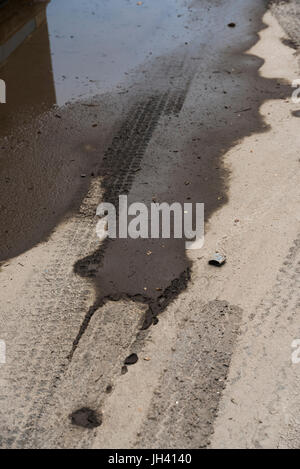 Background of Stagnant dirty rain water on roadside in Djibouti, East Africa - Stock Photo