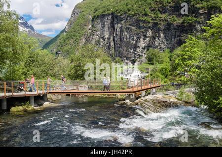 Pedestrian walkway and footbridge over Geirangelva river to village of Geiranger, Sunnmøre region, Møre og Romsdal - Stock Photo