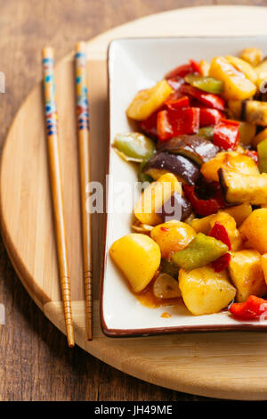 Stir-fried potatoes with eggplant and bell pepper. - Stock Photo