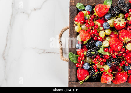 Summer fruit and berries. 6 types of raw organic farmer berries - raspberries blackberries blueberries strawberries - Stock Photo