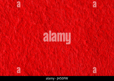 Abstract background with red felt texture, velvet fabric. - Stock Photo