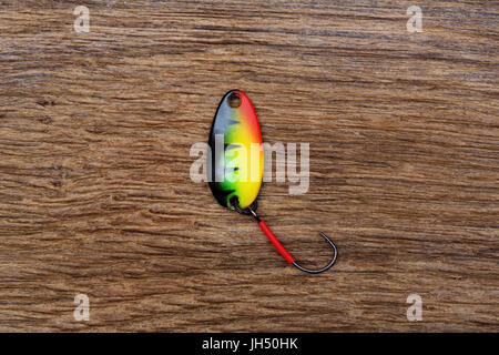Fishing lure on the old wooden table. - Stock Photo