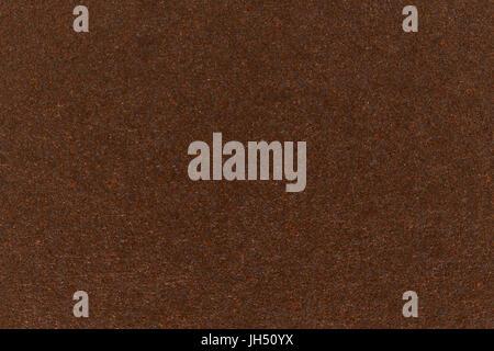 Dark brown paper texture cardboard background. - Stock Photo