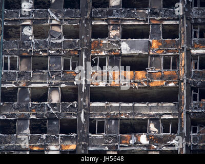 London, UK - Jul 4, 2017: Close up view of the Grenfell Tower block of council flats in which at least 80 people - Stock Photo
