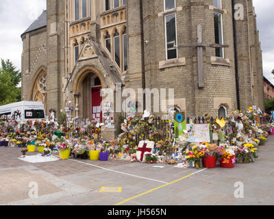 London, UK - Jul 4, 2017: Tributes left at a church in Kensington after the fire at Grenfell Tower block in which - Stock Photo