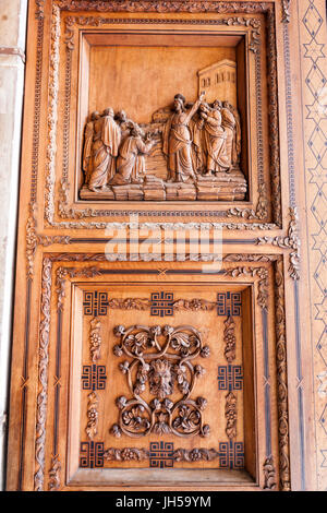 Wood carved in the main door to Cappella Palatina, Palatine Chapel,in  Palazzo Reale,  Palermo, Sicily, Italy - Stock Photo