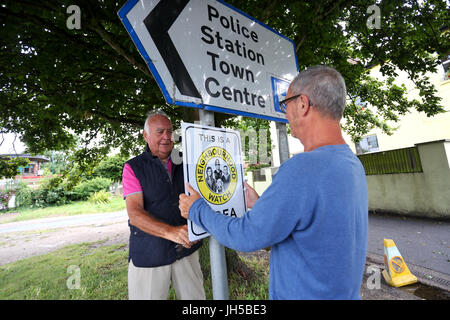 Members of a local Neighbourhood Watch pictured installing a sign in a street near their homes in Bognor Regis, - Stock Photo