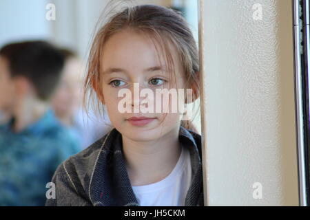 Pretty girl, blonde girl green eyes, pre-teen girl, beautiful little girl, girl with green eyes, girl stood by window, - Stock Photo
