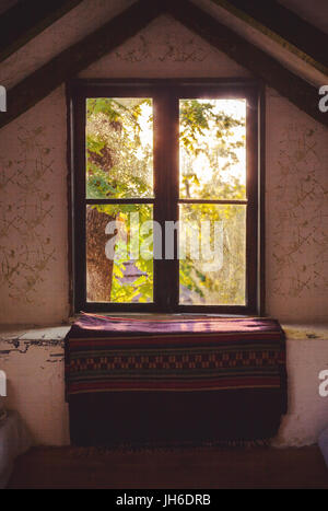 Interior detail of an old wooden house, window closeup. - Stock Photo