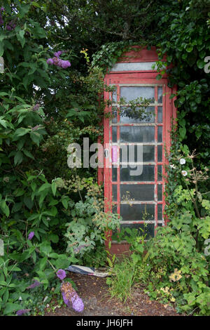 Distressed old style red British phone booth - Stock Photo