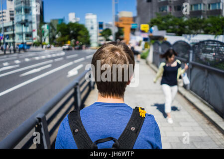 exploring the streets of tokyo - Stock Photo