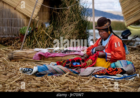 UROS ISLANDS, PERU - CIRCA October 2015: Woman from the Uros Islands in Lake Titicaca. - Stock Photo